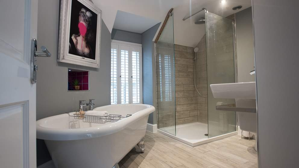 The upstairs uber-chic bathroom in dove grey boasts a claw foot roll top bath, roomy drench head shower underfloor heating and heated towel rail.
