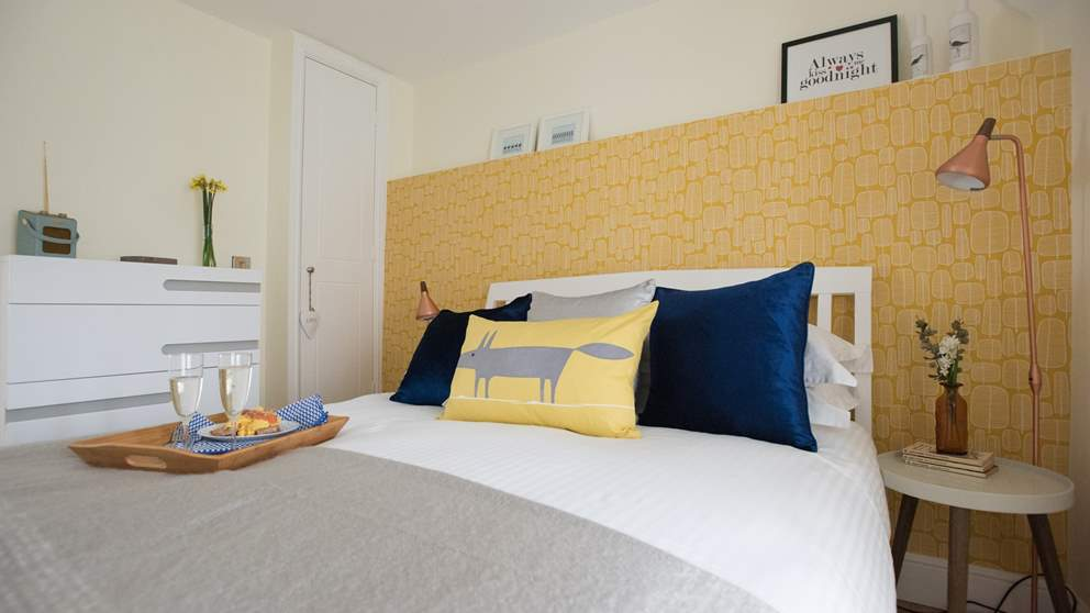 A lovely light and airy bedroom awaits you with original floorboards, a super comfy double bed, sunshine-yellow wallpaper and beautiful copper lighting.
