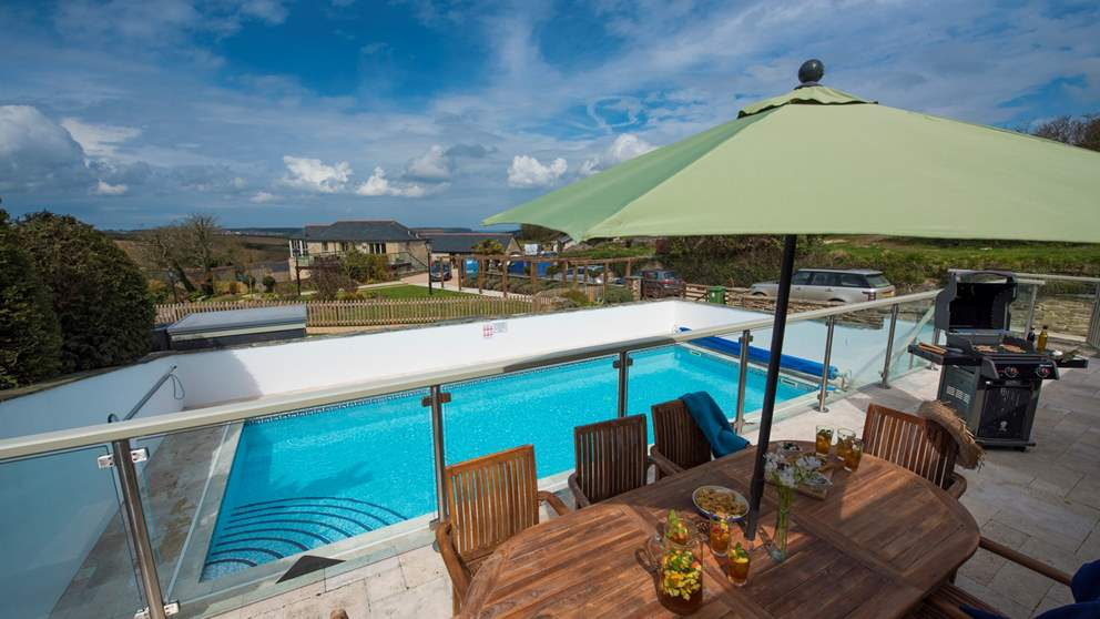 With spectacular views towards the Camel estuary and the stunning swimming pool.