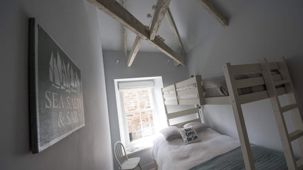The second bedroom has a bespoke bunk bed with a double bed on the bottom and a single on the top.