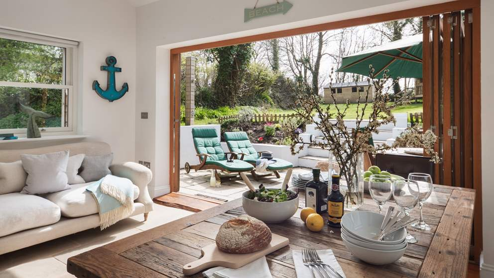 The open-plan kitchen/dining room brings the outside in during warmer weather