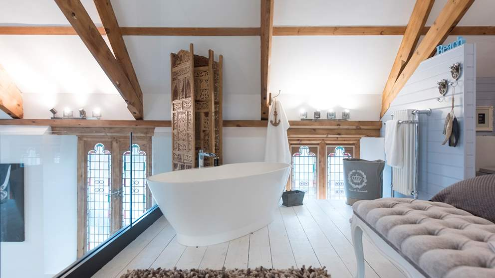 The pièce de résistance is the fab freestanding bathtub for two which overlooks the chapel below.