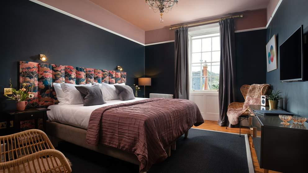 One of the five beautifully appointed bedrooms.
