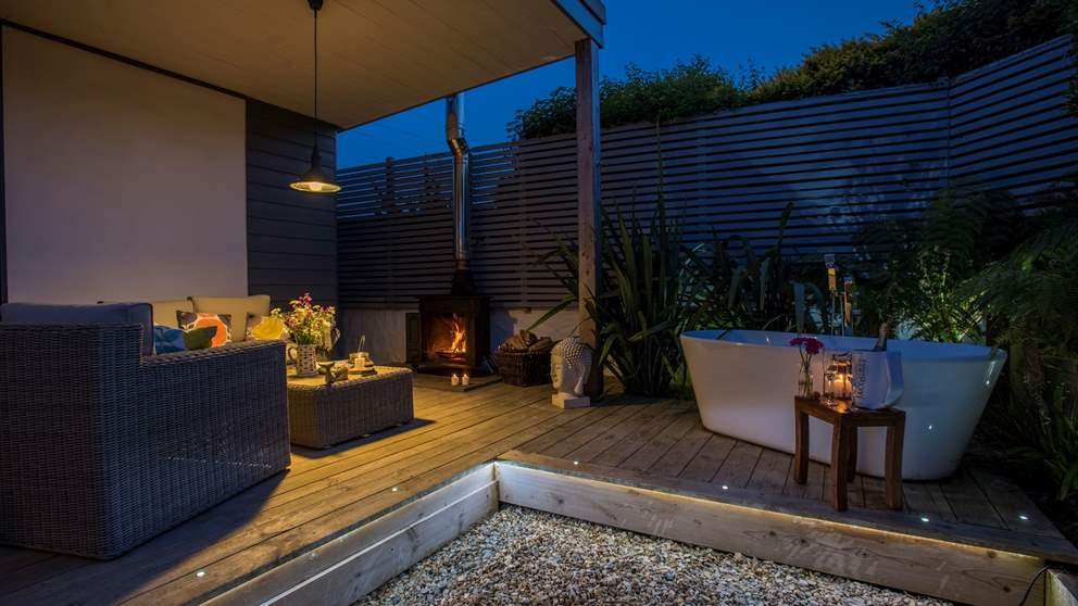 An alfresco wood burner plus an outdoor bath  - perfect for romantic evenings.