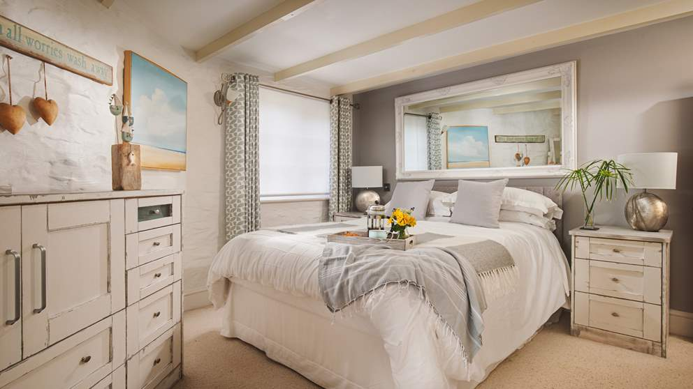 At the end of the day, withdraw to the delightful master bedroom where you'll find a laid-back-yet-lovely space to unwind