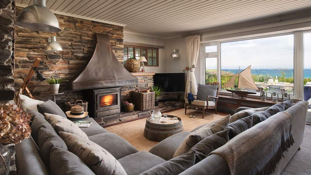 With huge windows overlooking stunning Harlyn Bay, the living area certainly makes the most of its views.