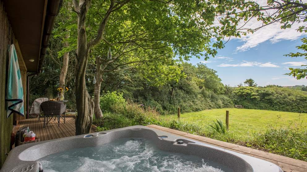 A gorgeous hot tub awaits you too - why not enjoy at night so you can gaze at the stars? Make sure to have a bottle of bubbles close by!