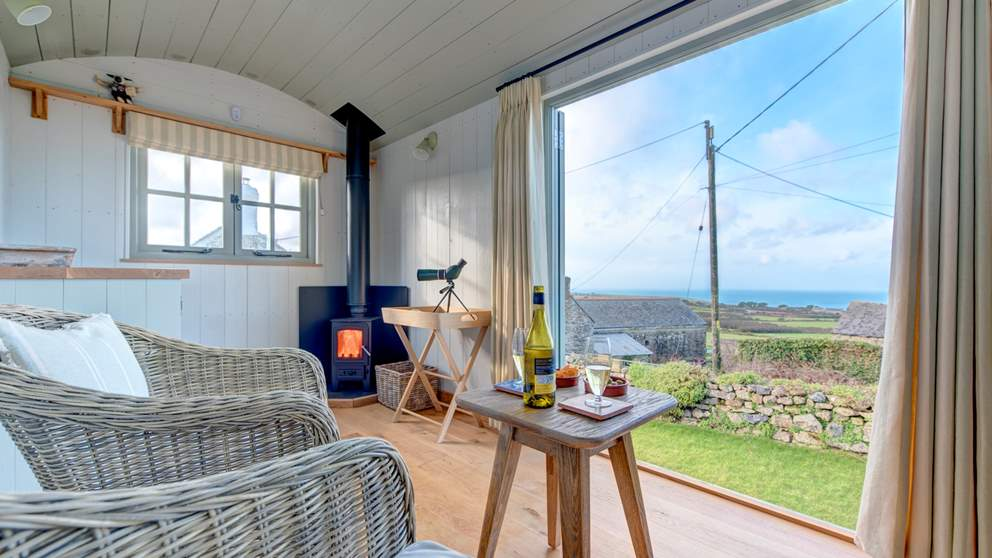 Make the most of the glorious sea views from the Shepherd's Hut in the garden!