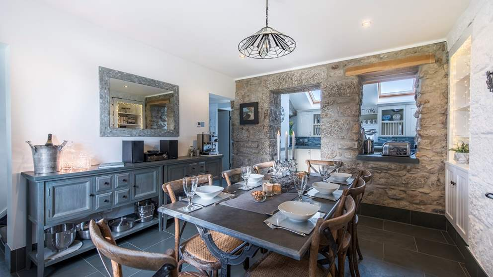 Exposed granite walls open onto the enticing dining room which is just perfect for feasts.