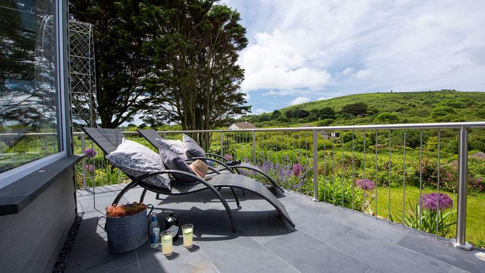 Take time out to unwind on the slate terrace which wraps around the sun room (loungers and deck chairs provided).