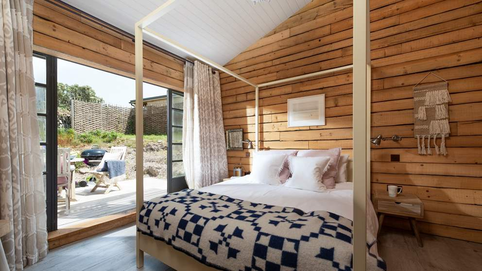 The master en suite bedroom is totally gorgeous, with a king size four-poster bed.