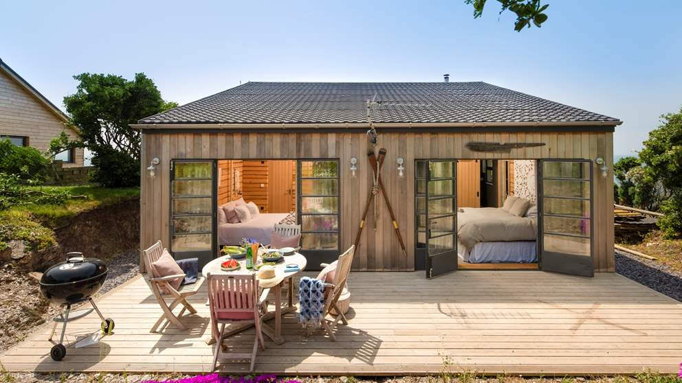 This corker of a retreat is a super-luxe cabin - Step out of the bedrooms onto the rear deck for breakfast al fresco.