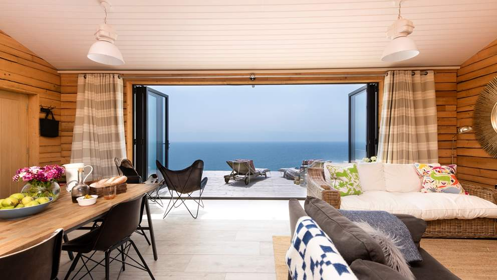 The stunning open-plan living space certainly makes the most of the unique views, with bi-fold glass doors that open out on to the large terrace overlooking the sea.