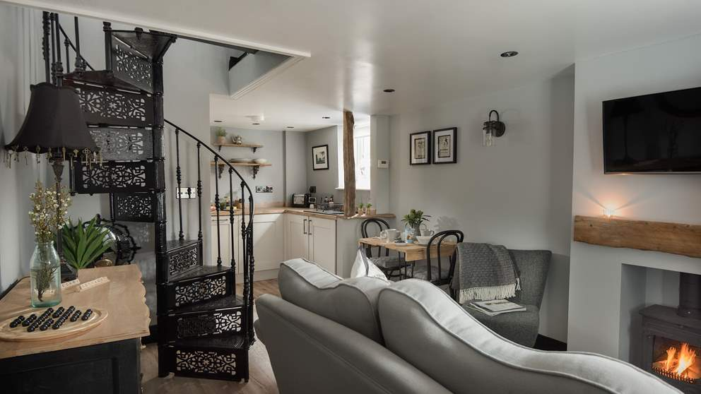 This bijoux cottage for two is cosy yet open plan in stunning shades of grey and black.