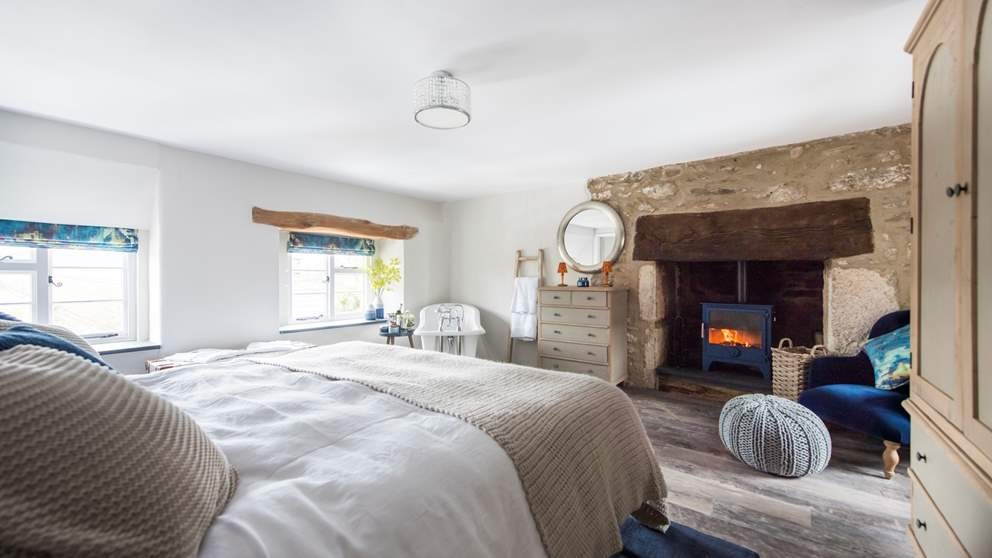 The incredible en suite master bedroom has a sumptuous Loaf super king bed as well as a fabulously romantic freestanding slipper-style bath and even a wood burning stove.