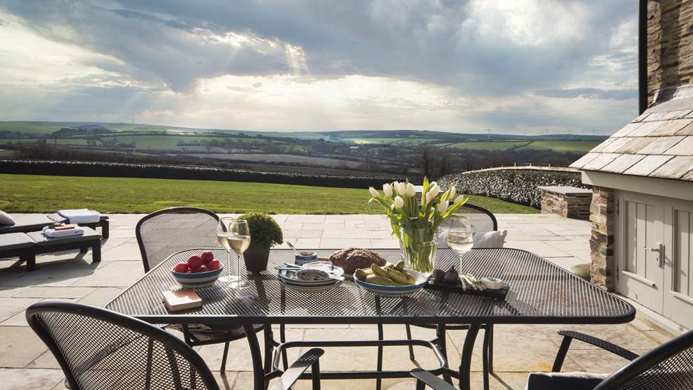 A step leads outside from the bi-folding doors and Trevear Lodge is encircled by a lovely stone terrace