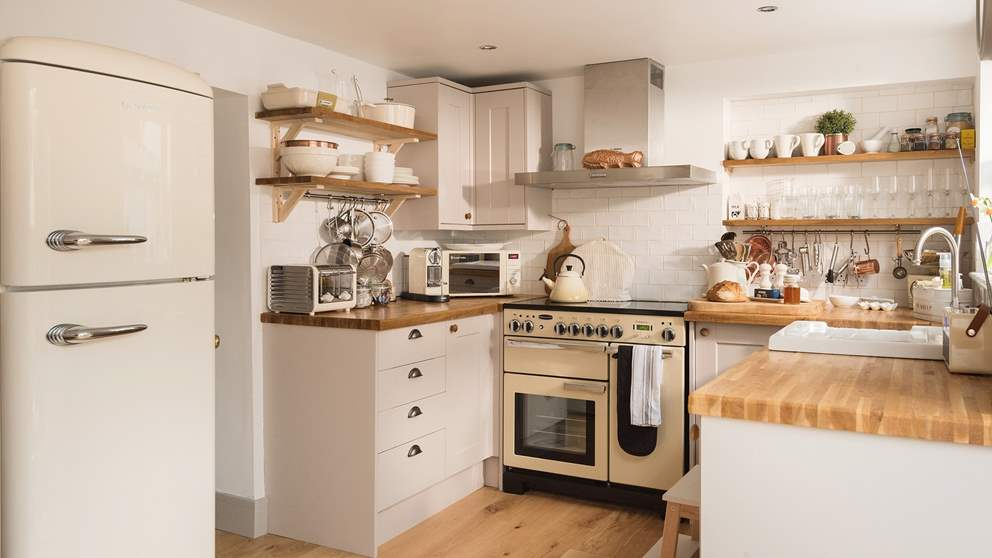 Totally country chic, the super-cute kitchen is just lovely with wooden work surfaces, butler's sink, cream Rangemaster cooker and all the mod-cons you need.