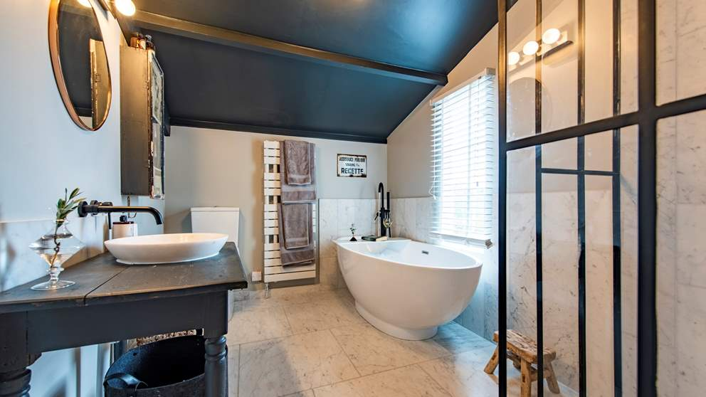 Just wow - the marble-lined bathroom has an incredible, oval free-standing bath made for long soaks with plenty of bubbles.