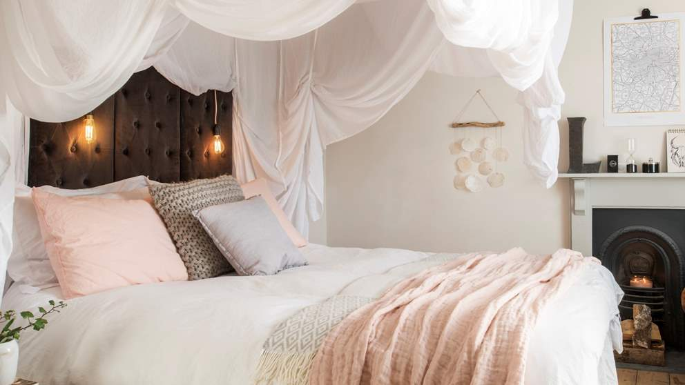 We don't think we've met a more romantic bedroom. With voluptuous swathes of soft white cottons hiding the bed like the sails of the ship.