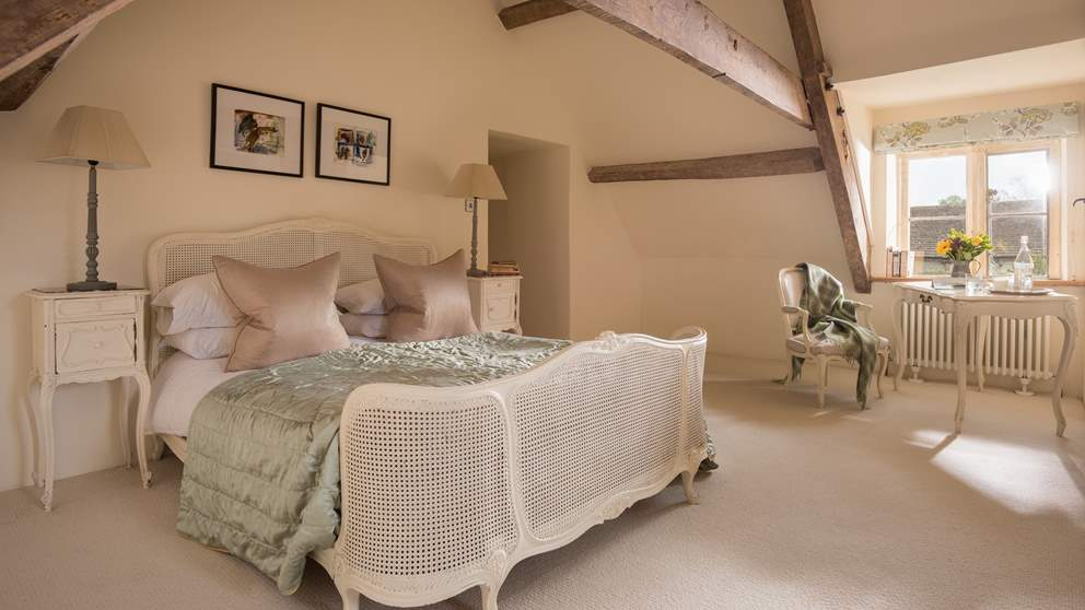 The wonderful master bedroom in shades of soothing cream is made for long, luxurious lie ins.