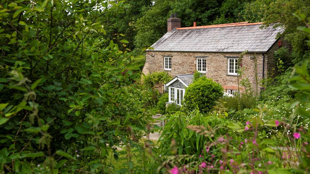 Hidden at the end of a meandering lane and set within a picturesque wildflower garden, Rose Cottage is the epitome of a traditional Cornish country home.
