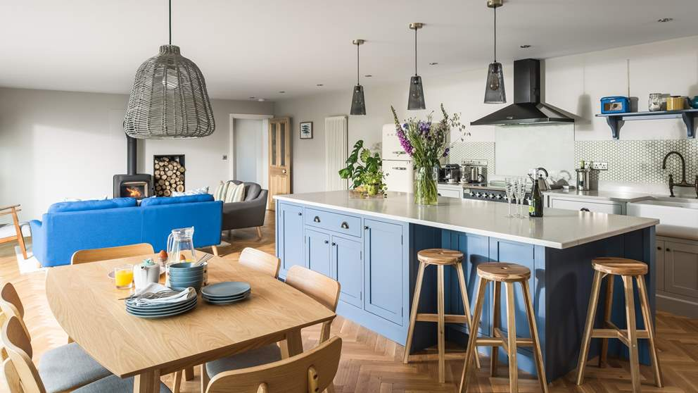 The Scandinavian-designed open plan living, dining and kitchen area covers most of the ground floor and boasts floor-to-ceiling glass windows.