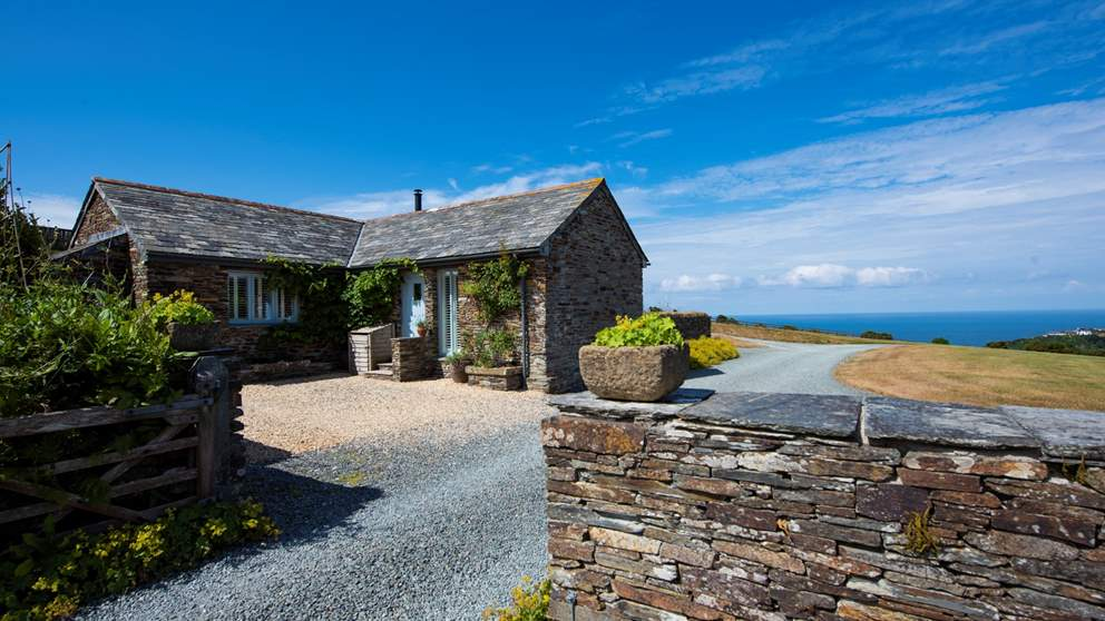 This exquisite stone barn conversion is the very essence of Cornish coastal chic