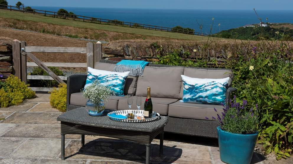 The private terrace and garden, there is also a choice of comfortable seating to enjoy the fabulous and panoramic views of the North Cornish coast
