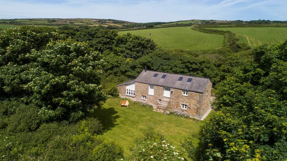 A lovingly converted 18th century cow barn nestled in the wilds of West Cornwall, this is an escape-it-all retreat for four.