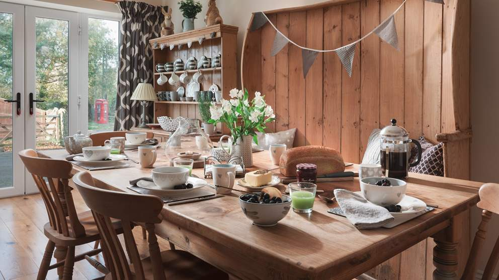 The kitchen is a lovely space with a real country feel. With wooden floors throughout, a period dresser, additional country-style table and seating for eight.