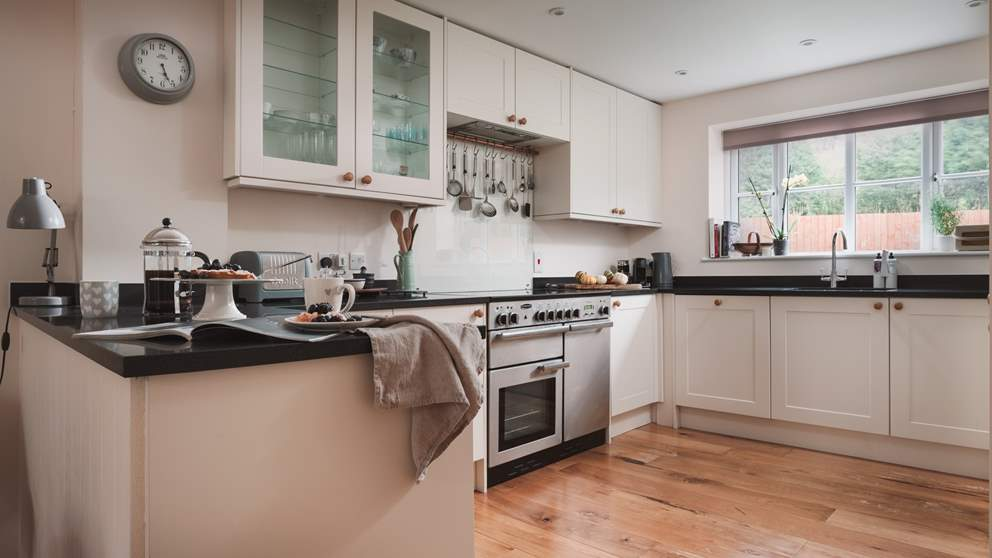 The kitchen is beautifully equipped with a Rangemaster oven and fully integrated appliances and an all-important Nespresso coffee machine.