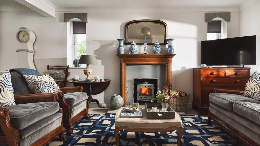 The sitting room is just stunning with a bijoux wood burning stove