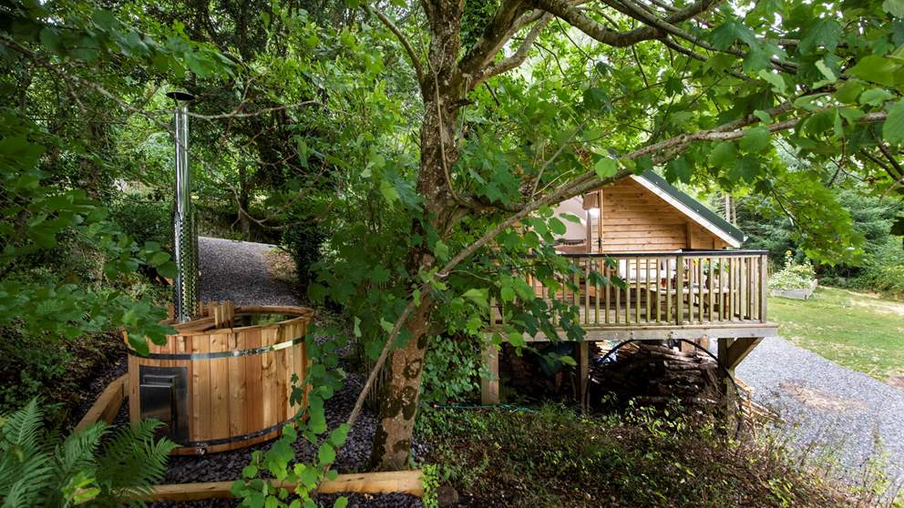 Nestled amongst the tress, this wooden retreat is a country idyll for couples.