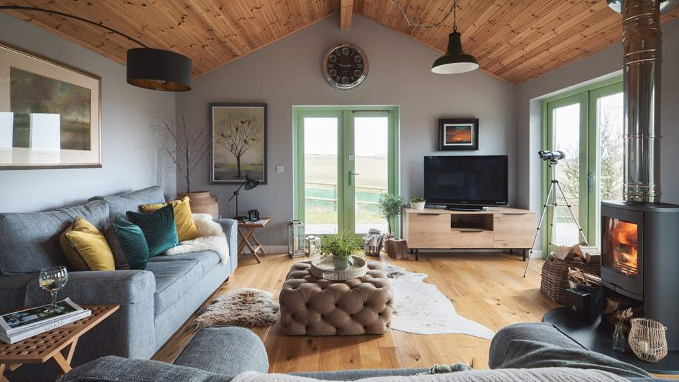 The open plan living space has plenty of room for two, with amazing views over the moors