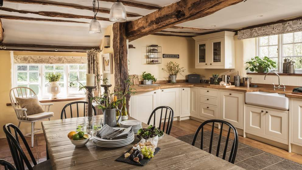 The gorgeous country kitchen with beams offers plenty of space for entertaining.