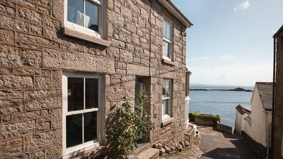 Gwella is a beautiful stone cottage for four nestled in iconic Mousehole.
