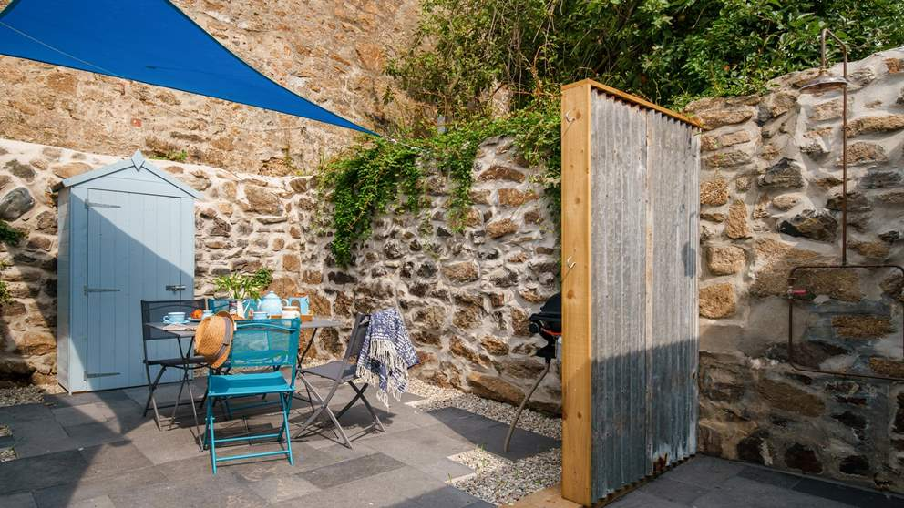 The tucked-away, secluded courtyard garden is a real sun trap - ideal for alfresco meals!