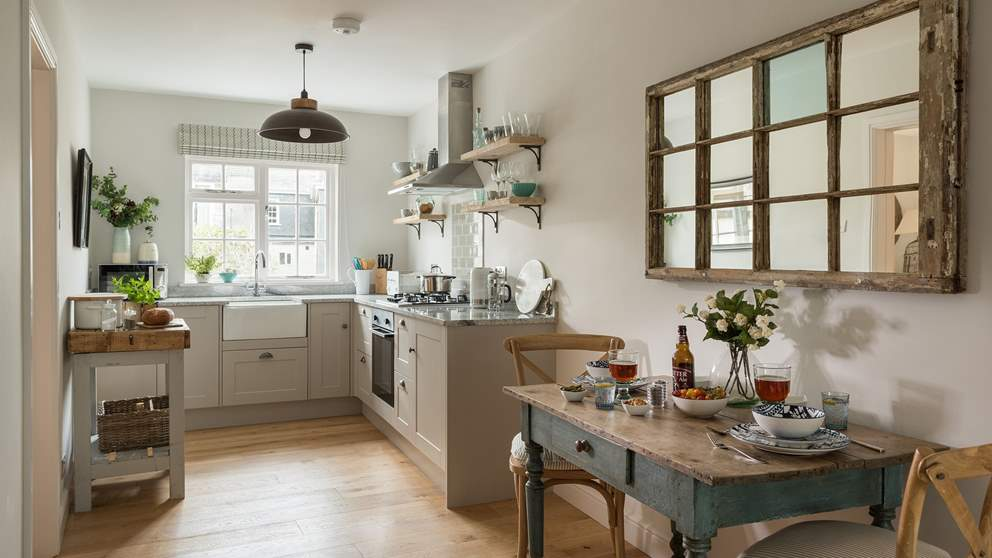 The cute kitchen has everything you need to rustle up meals, including a gas hob and electric oven, Belfast sink, butcher's block work surface and microwave.