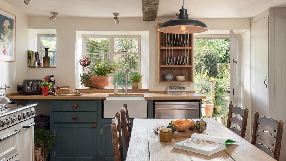 The relaxed, country-style kitchen oozes charm while affording modern luxuries.