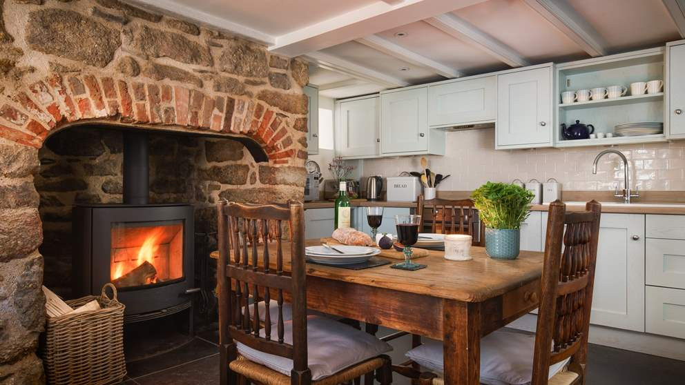 The wonderful, cosy kitchen with original fireplace is made for decadent dinners and lazy lunches.