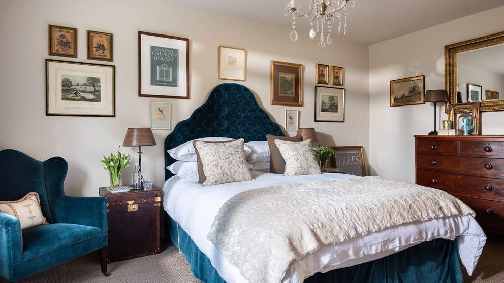 There are two sumptuous bedrooms, each totally individual in style. We just love this teal colour.