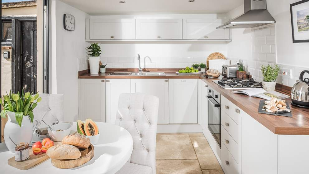 The perfectly-equipped kitchen has everything you'll need to rustle up meals and snacks