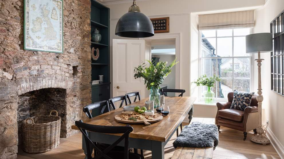 In between the kitchen and sitting room lies the dining room with a lovely table that easily seats eight.