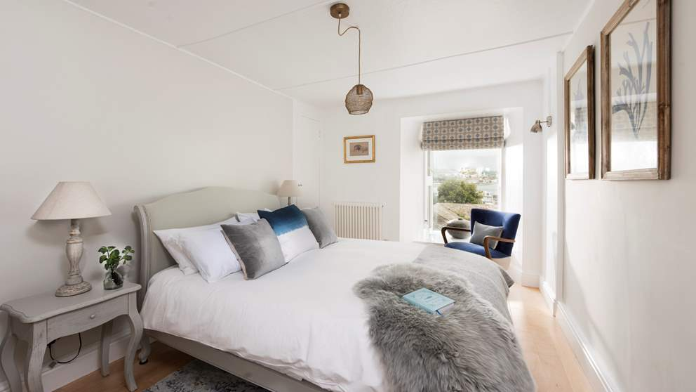 The master bedroom lies to the front of the property and boasts lovely sea views which you can gaze at from the sumptuously cosy king-size bed.