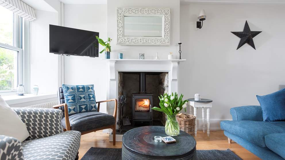 The beautiful sitting room is a joy in shades of blue, grey and white.