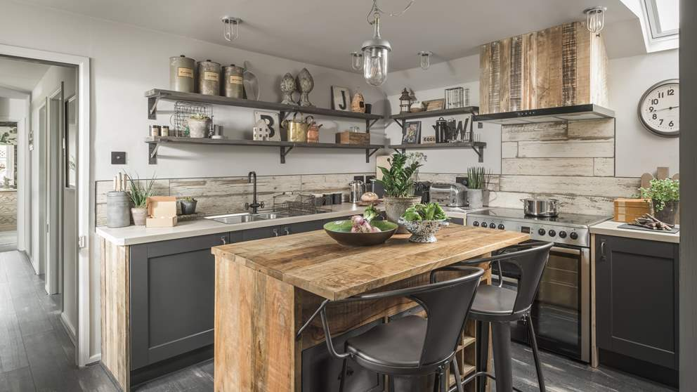 The gorgeous kitchen in shades of grey and natural wooden touches is just a dream to cook in