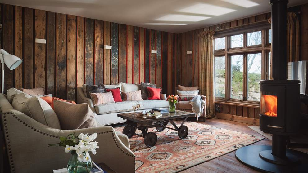 The gorgeous sitting room with wood burner is the perfect spot to relax in, whatever the weather