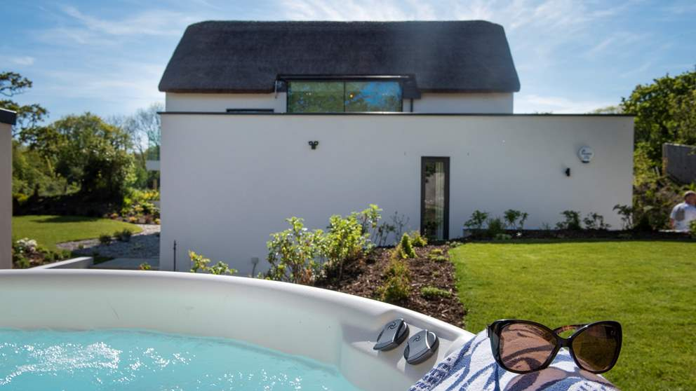 Relax in the wonderful hot tub, nestled in the gorgeous gardens.