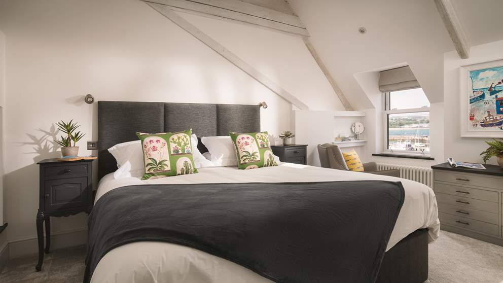 The master bedroom is gloriously spacious with a beamed vaulted ceiling, a luxurious super-king 6ft bed.