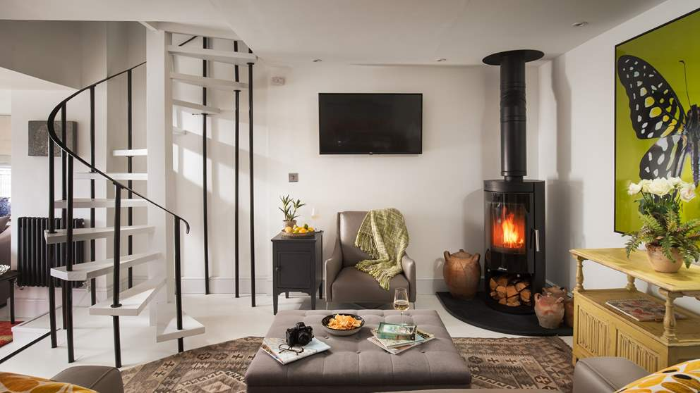 Luscious sofas nestled around the huge wood burner - perfect for cooler evenings.